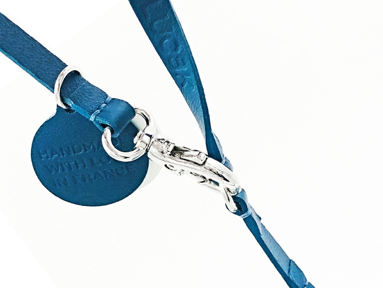Detail of the lock from the charm with blue leather straps