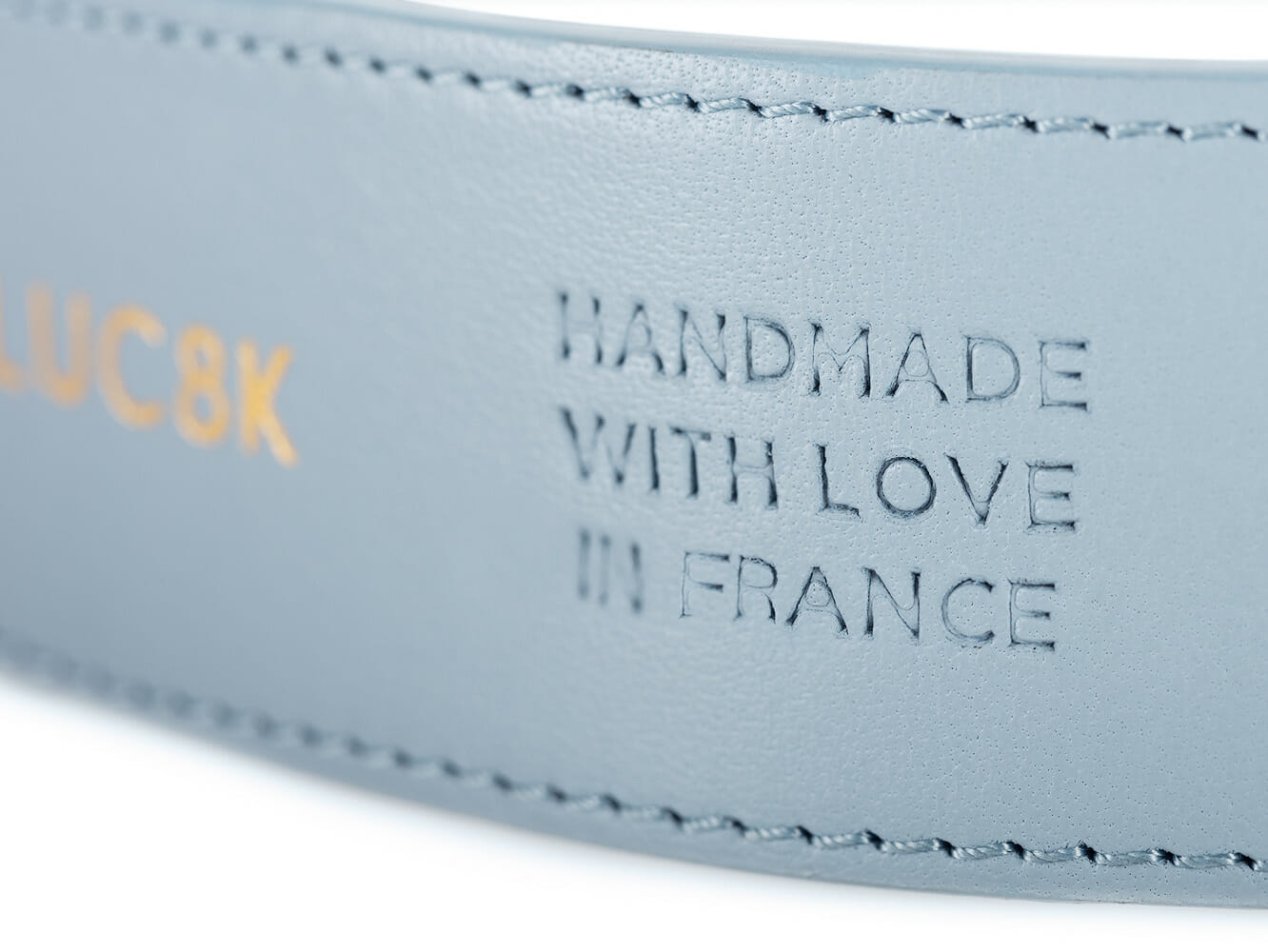 handmade with love in France embossed into a leather belt