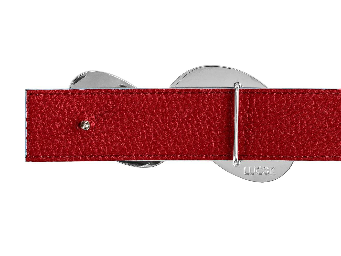 Handmade leather belt with silver buckle showing the mounting on a designer belt