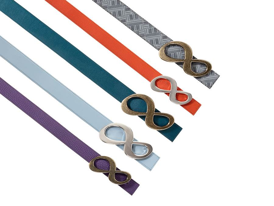 Handmade leather belts, 5 different coloured leather belts on white background, purple, sky blue, petunia green, red and canvas belt