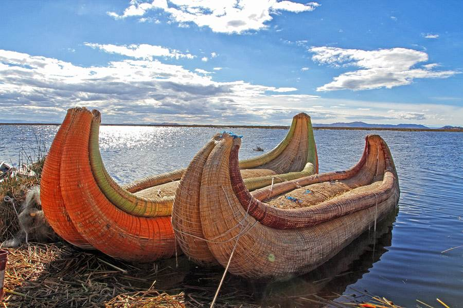 Lake Titicaca historical boats at the edge of an island in the lake