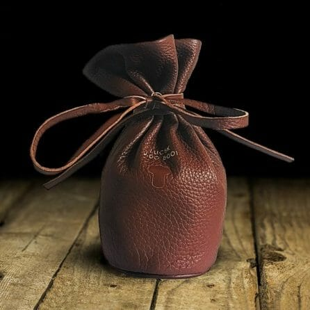 Leather pouch for Jacky Donatz in brown color and black background
