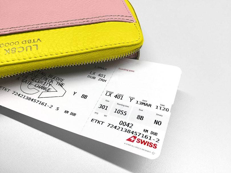 Bespoke Leather Wallet in yellow and pink with an airline ticket