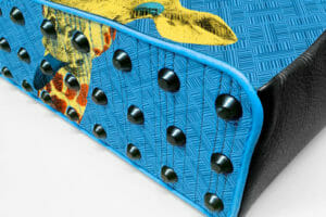 Handcrafted custom leather bag made in France in blue, black and giraffe head