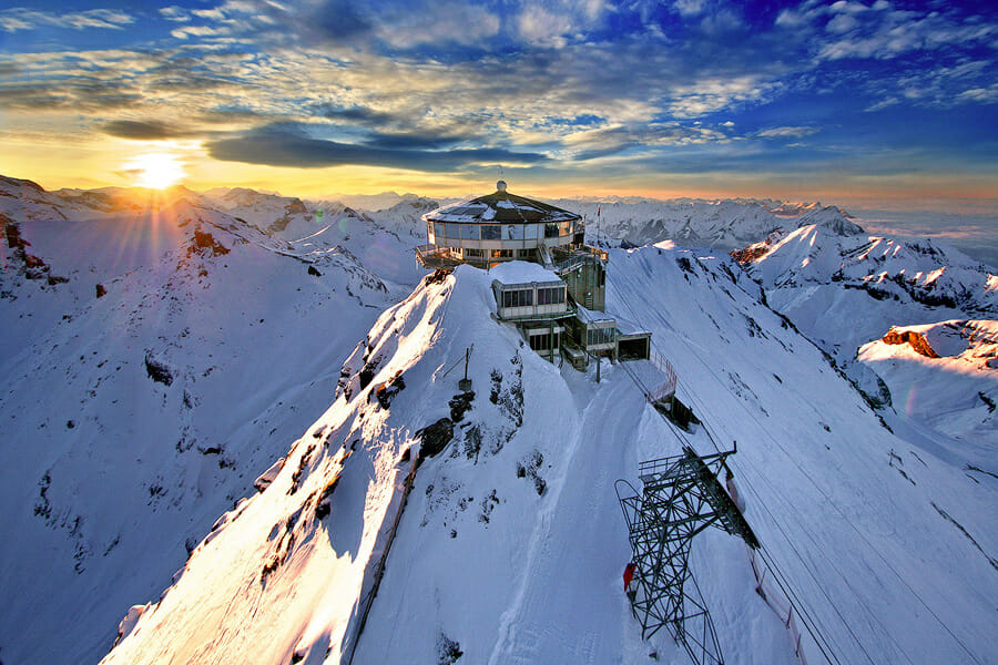 Schilthorn in Switzerland at sunset. beautiful clouds in the sky. Sophie travels Switzerland