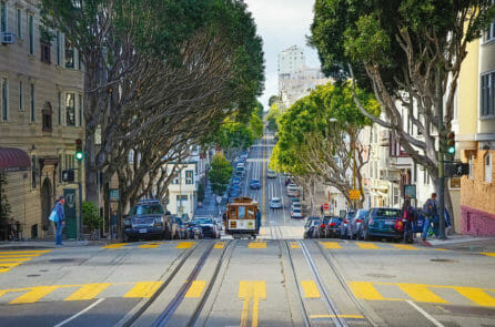 Sophie Goes Off The Beaten Path in San Francisco, cable car driving down hill in a street of San Francisco
