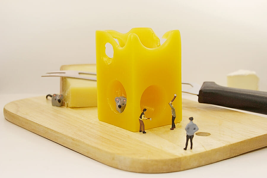 Swiss cheese with holes. How come the holes into the cheese in a comic way shown